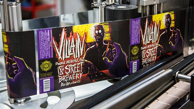 villain beer labels on automated label application machinery