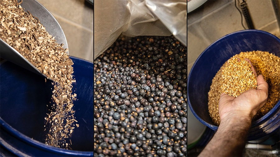 trio of raw alcohol distilling ingredients including fruit chips, flakes and juniper berries