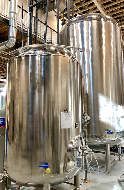 stainless steel cider-chilling bright tanks in a warehouse