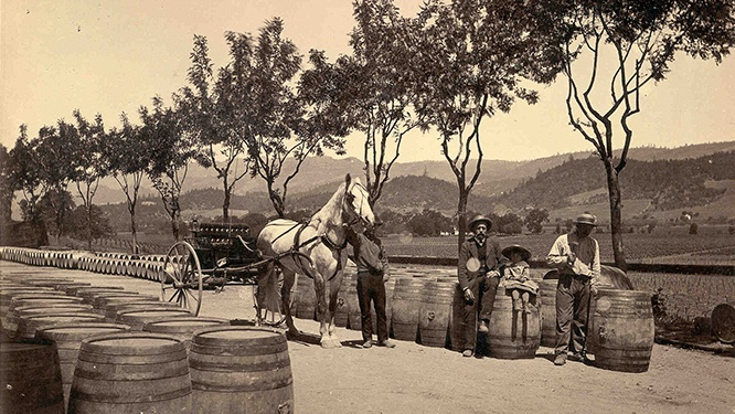 Beringer Brothers preparing to load wooden wine barrels onto a horse and buggy in 1876