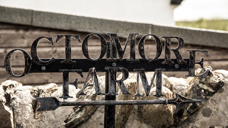 metal outdoor Octomore Farm sign with an arrow pointing rightwards