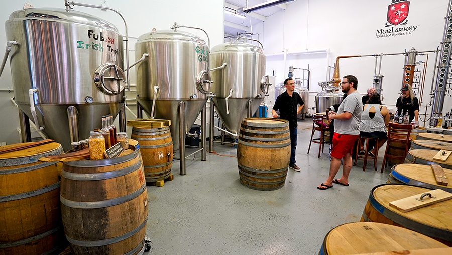 room with small-batch stainless steel fermentation tanks and barrels thats used for tours and tastings