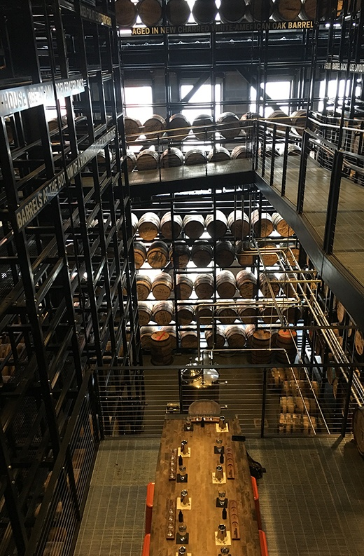 multi-level steel rackhouse completely filled with full whiskey barrels