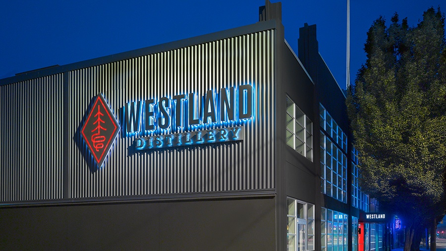 Exterior view of the Westland Distillery sign on the side of their distillery