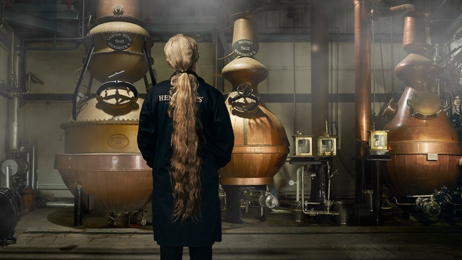 Lesley Gracie overlooking the three stills inside the distillery at Hendrick's Gin